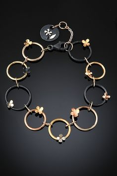 Bracelet | Debra Balazer. 'Ring Around The Rosy'.  Solid 14K yellow, white and rose gold; Black silver