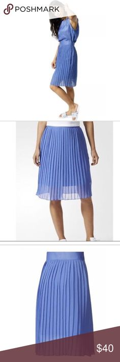 Adidas pleated skirt With a nod to vintage style, the Ocean Elements Pleated Skirt is ready for a laid-back day at the beach. Made of breezy, sheer pleated chiffon, this women's skirt has an inner opaque satin slip. It zips up along a side seam and shows off a Trefoil logo on the left hip.   Concealed side seam zip  Tonal Trefoil logo on left hip  Regular fit  Outer: 100% polyester chiffon; Lining: 100% polyester satin  Product code: CF9973  Product colour: Aerblu adidas Skirts Midi