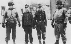 Captured Hitler Youth (Hitlerjugend) during the Batlle of the Bulge, Bastogne, Belgium, Ardennses, December 1944.