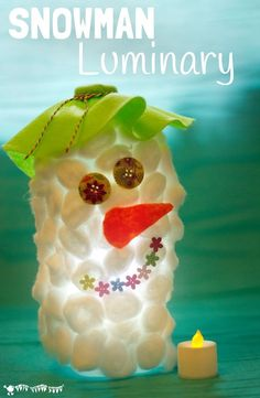 These fluffy Snowman Luminaries look cute during the day and just adorable glowing in the evenings! An easy and frugal recycled snowman craft for kids.