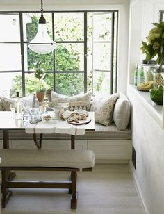 Bright window breakfast table seating - comfy seating in the breakfast nook, bench on the outside, more cheerful colors