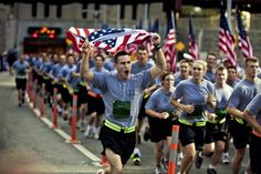 A Soldier sprints to the formation while carrying an American Flag during the New York City Tunnel to Towers Run, Sept. 30. United States Military Academy at West Point cadets and FDNY firefighters lined the final stretch of the run. The run is in support of the Stephen Siller Tunnel to Towers Foundation, which works to build homes for injured troops and provide scholarships to the children of fallen service members and firefighters. Siller was an off-duty New York City firefighter who…