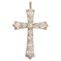 Edwardian Antique Cut Diamond Cross Platinum Pendant with Diamond Bail | From a unique collection of vintage pendant necklaces at https://www.1stdibs.com/jewelry/necklaces/pendant-necklaces/