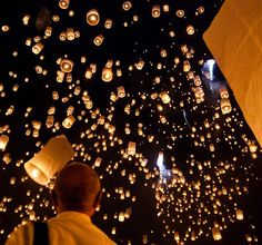 Make and release a khom loi during the Yi Peng Festival in Thailand
