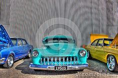 1950s light blue American custom Ford Mercury with chopped roof on display at car show in Melbourne, Australia