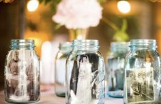 DIY #Vintage #Wedding Decor: Put photos of loved ones inside of mason jars and secure the photo by adding some small rocks to the bottom. Then, fill the mason jars with vegetable oil to add a sepia-like effect.    Love this for out door decor, add a couple of floating candles in smaller mason jars to the sides. #ProjectDressMe
