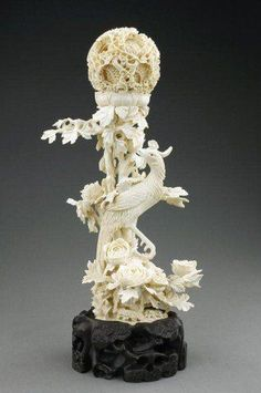 Exquisitely carved ivory puzzle ball with a phoenix. The peonies, the phoenix and the puzzle ball all represent femal. Ancient Egyptian Tombs, Bone Carving, Chinese Art, Asian Art, Japanese Art, Sculpture Art, Horns, Hand Carved, Quartz