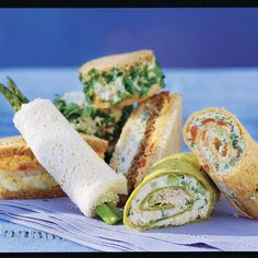 """Southern Living 21 favorite finger sandwiches for a luncheon. """"Freezing bread slices until firm makes it easier to cut the sandwiches into small pieces. To ensure neat edges, cut the crusts from the bread with a long serrated knife after the sandwiches are filled."""""""