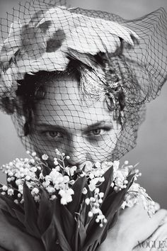A close-up of a Suzanne Couture Millinery feather hat on Sasha Pivovarova.    Photographed by Arthur Elgort, Vogue, June 2009