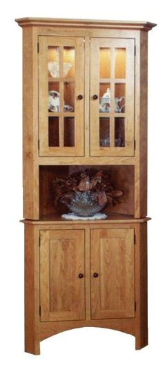 Amish Shaker Corner Hutch  Amish Furniture Hutch Collection  Our lovely Amish Shaker Corner Hutch showcases and protects your dining supplies and china sets while also saving space. This hutch off
