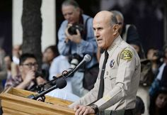 Lee Baca announces his retirement during a news conference at Los Angeles County Sheriff's headquarters in Monterey Park