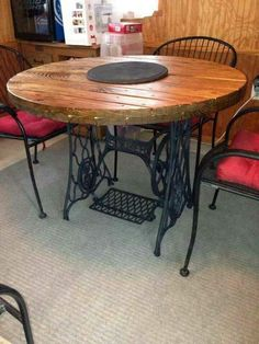 Old sewing machine base  becomes table legs.