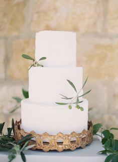 simple white three tier wedding cake   Photography: Kurt Boomer