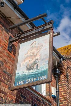 The Ship Inn pub sign with a painted warship on the ocean wave. The Ship Inn, British Lions, Old Pub, Pub Signs, Battle Of Britain, You Are The World, Isle Of Wight, Grand Hotel, Ocean Waves