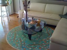 """""""Cherry Blossoms"""" circle floorcloth in the living room."""