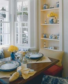 A comfortable window seat makes banquette seating for two or three around
