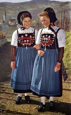 Europe | Portrait of two girls wearing traditional clothes and headdress, Switzerland