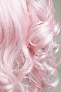 Pastel pink long curly dyed hairstyle - http://ninjacosmico.com/28-crazy-hairstyles-ideas/