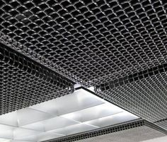 Texture upon Texture. Banker Wire's conference room is the perfect location to display their most recent wire mesh creation. The Banker REVEAL ceiling tile system breaks the plane and accents the gridwork surrounding the room's center light. Texture, color, and depth of the tiles can create perfect contrast. The controllable reveal edge provides uniformity as well as unique texture on the ceiling surface. Product(s) Used: 2 mesh .105 Lockcrimp