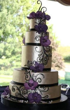 silver cake with purple flowers: