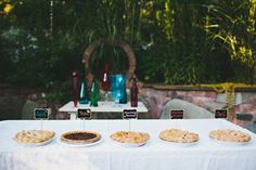 Robots, I Spy, s'mores, and a secret get-away table Wedding Pie Table, Wedding Pies, Farm Wedding, Wedding Cake, Reception Food, Outdoor Wedding Reception, Wedding Receptions, Cupcakes, Offbeat Bride