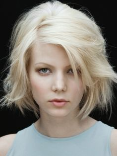 Classic Medium Haircuts Redone - This season, medium haircuts get a modern update with lots of layers and a bouncy texture.