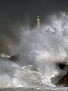 Lighthouse vs Waves. I want to go see this place one day. Please check out my website thanks. www.photopix.co.nz