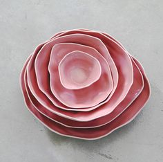 I would love to make a set of dishes like this. They would be really pretty in a darker salmon color, or in raiku style natural glazes.