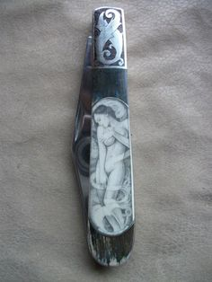 Scrimshaw artist and custom knife maker Dan Farrell. You've gotta see it to believe it! So talented, so beautiful! www.FarrellScrimshawKnives.com