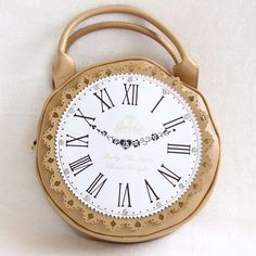 """Clock Purse Super cute tan clock purse! Some dents on the back of the purse and scratches shown in last photo. Hardly noticeable. Diameter of purse: 10"""". Comes with detachable straps and dust bag. Bags"""