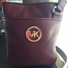 """Michael Kors Cross Body Authentic Color is Merlot/Burgundy Strap Drop up to 26"""".  W8""""H9""""D 1/2"""". Has Pen mark inside lining on one side only. Strap is tan but has 2 small pen    marks. See Pictures. Strap does show some wear & tear. Pebble Leather is in great condition. No Scuffs or Scratches                          ❌No Trades ❗️PM Only❗️Gold Tone Hardware has minor scratches! Michael Kors Bags Crossbody Bags"""