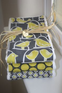 too girly for baby reese?  Baby Burp Cloths- 3-Pack Coordinating - Love Birds in Citron. $21.00, via Etsy.