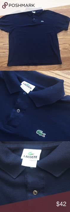 Navy men's classic Lacoste polo Navy blue AUTHENTIC Lacoste polo. Size 7. Lacoste Shirts Polos