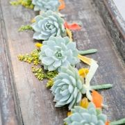 Love the idea of using succulents in the flowers!