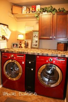 Add a counter over washer and dryer and drawers in between by concetta