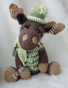 """This fun fellow works up quickly with worsted weight yarn and a G hook. Pattern includes detailed written instructions (in English), material list, photos and notes and tips to help finish this happy guy. Finished size approx. 13.5"""" from top of head to bottom of feet, not counting ears, hat or antlers."""
