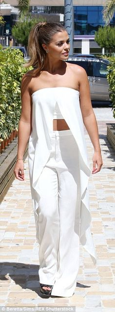 Trim: Chloe made the most of her impressive physique in her all-white ensemble...