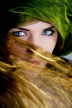 Green, gold veil with ice blue eyes.