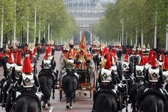 Queen Elizabeth II leaves Buckingham Palace to address Parliament at the official State Opening of Parliament ceremony on May 9, 2012 in London
