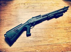Remington 870 shotgun ghost ring sights with what looks like a Mesa Tactical Urbino stock and Surefire lighted forend. Mesa Tactical, Tactical Shotgun, Remington 870 Tactical, The Evil Inside, Pump Action Shotgun, Home Defense, Swords, Winchester, Firearms