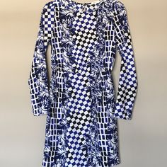 Everly dress Beautiful Everly dress in rich blue and black pattern. Very slight puff in shoulders. Excellent condition. Small fabric flaw on one sleeve - see last picture. Everly Dresses