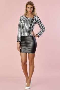 Black leather miniskirt, houndstooth top, white heels