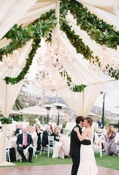 Photographer: Michael Radford Photography; Stunning outdoor white tented wedding reception with hanging greenery decor;