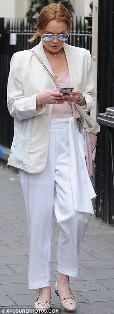 Feline fine: She wore a spring-appropriate ensemble that included a cream blazer and pink ...