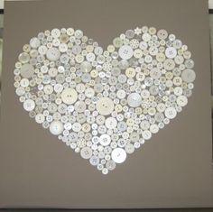 Mooi hart van knopen op een canvas doek