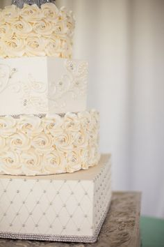 Feminine and classic tiered wedding cake with round and square design
