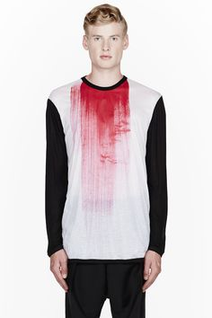 DENIS GAGNON //  Red Painted JErsey BAseball Crewneck  32410M055003  Long sleeve crewneck baseball shirt in white with contrast sleeves in black. Ribbed collar. Painted detail at front in red. Ribbed trim at sleeve cuffs and hemline. Sem-sheer. Tone on tone stitching. Body: 100% rayon. Trim: 100% cotton. Hand wash. Made in Canada.  $175 CAD