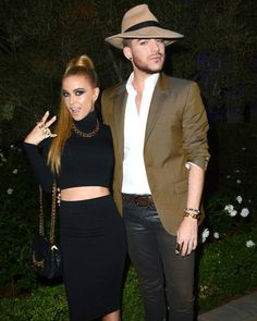 Carmen Electra and Adam Lambert striking a super sexy pose in celebration of Marco Marco