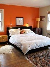 orange accent wall. Thinking about going bold in the guest bedroom. Orange accent wall, but with darker brown on the other walls :)