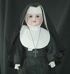 Grandma gave Mother a nun doll when she was small.  The nuns at the school made the clothing.